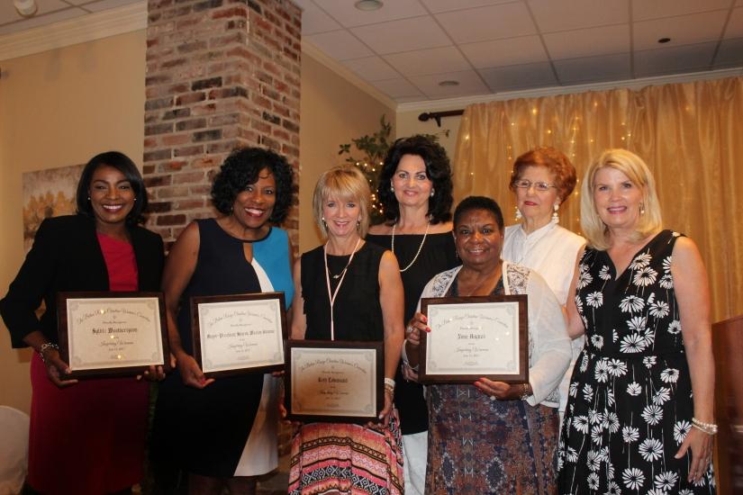 Beth a group of women, recieving an Inspiring Woman award